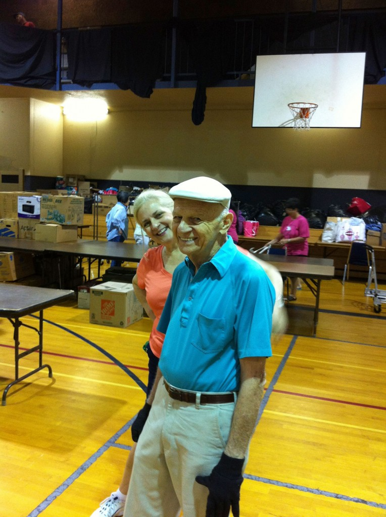 Bennie Sikorski and daughter Belinda at the July 2013 rummage sale set up.