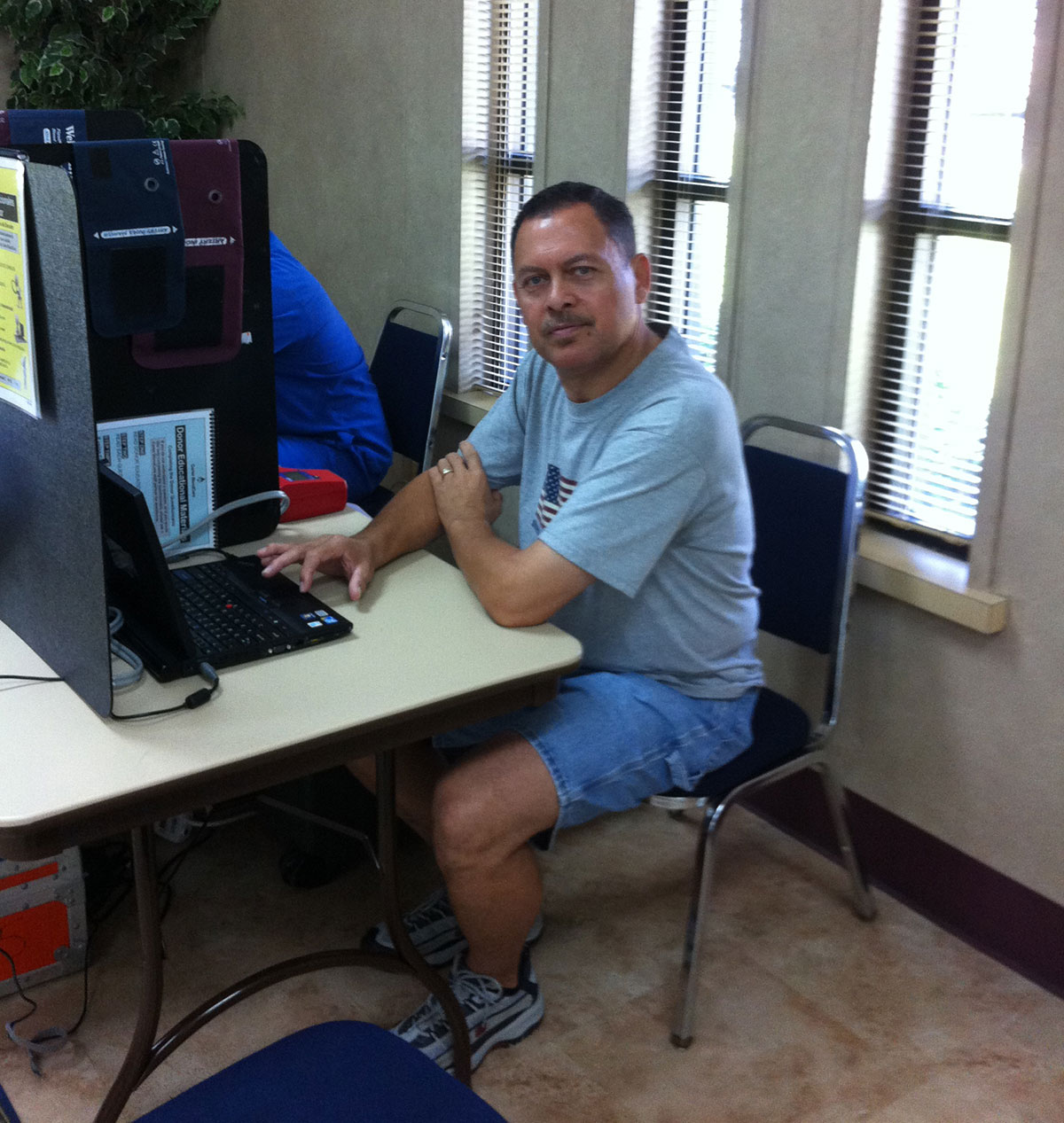 john-espree-at-blood-drive-computer