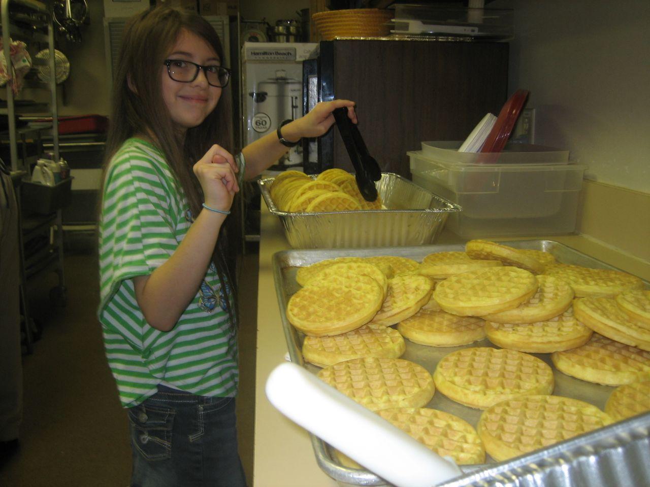Ms. Madison Goza preparing waffle trays