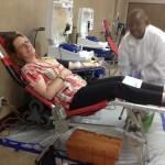 Marianne Rizo is monitored by CBC tech as she gives blood