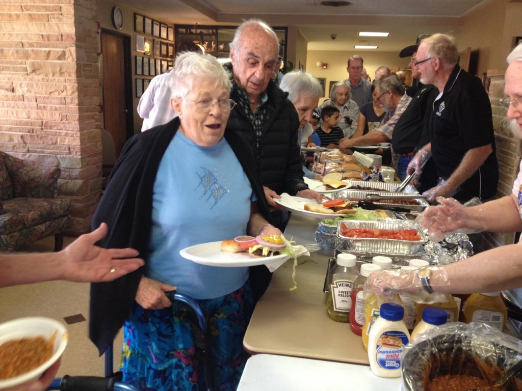 Senior residents going through the line as Knights of Council 8157 serve lunch.