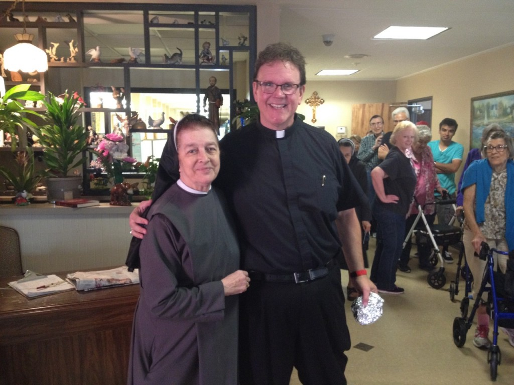Director Sr. Carolina Sanchez Botero, and Fr. Mike Dugan of St. Elizabeth of Hungary in Dallas.