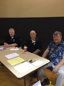 Sign up table staff. From left are Andy Goza, Art Senato and Pat Stepsniewski.