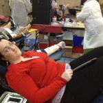 Rebecca Reetz gives blood as her family awaits nearby