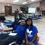 HSCC Youth group member Lissette Torreblanca poses with dad Alberto as he gives blood