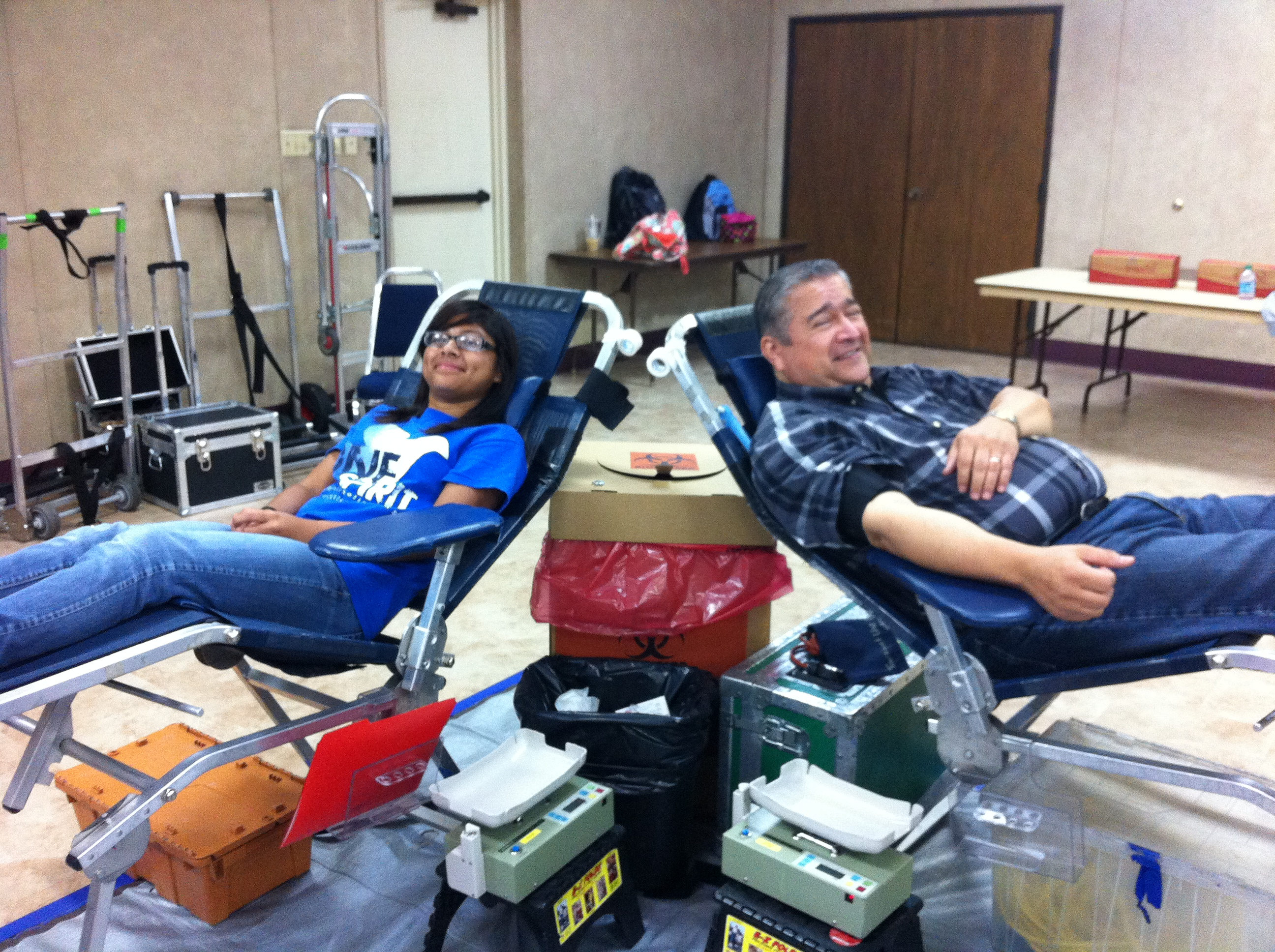 16 year old Lissette Torreblanca waits to give blood for her first time as Knight Carlos Favela cheers her on