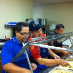 Mario Ramos, John Espree and Daniel Rosales at the serving line