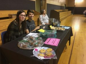 Youth selling baked goods at fish fry