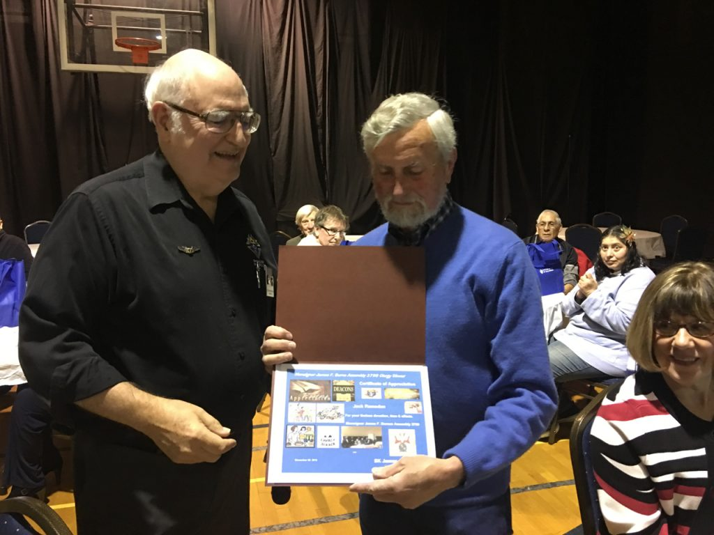 Jack Ramsden receiving certificate of appreciation from FN Jim Russell.