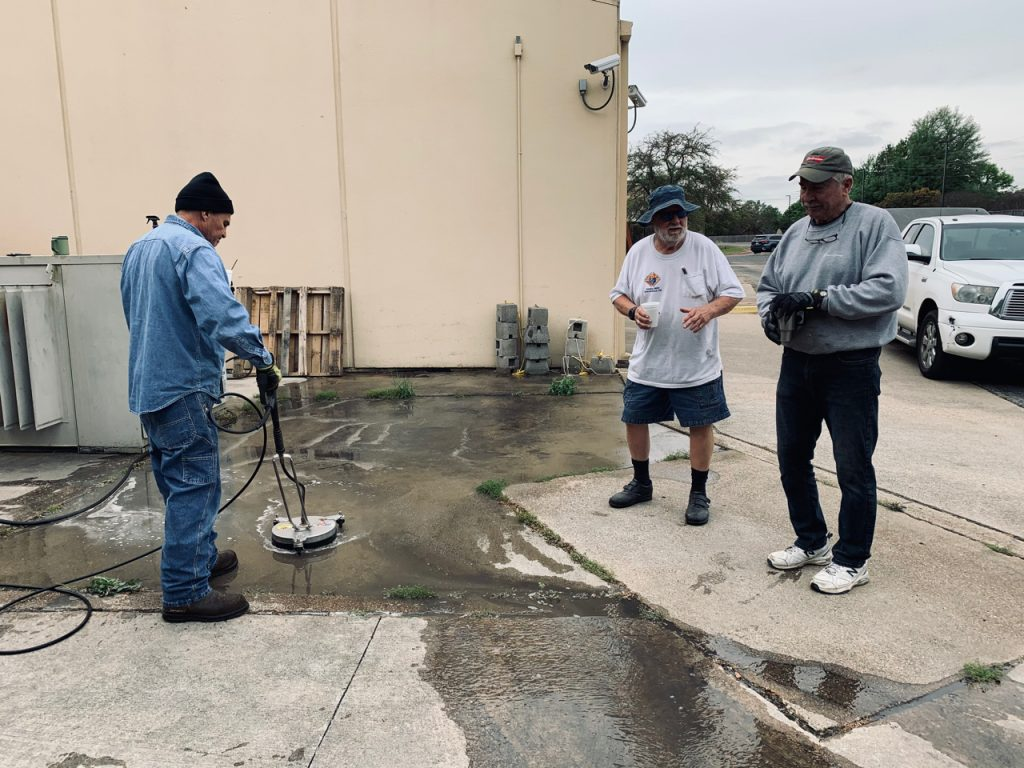 Jose Montoya power washing concrete